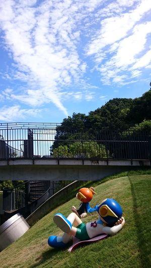 Cartoon characters look at the sky. Fujimoto Hiroshi Japan Tokyo Architecture Childhood Cloud - Sky Day Grass Lying Down Sky