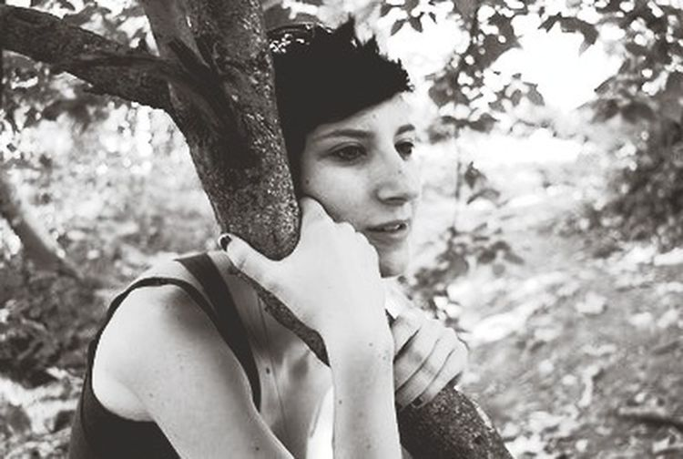 Breathtaker surveys. Portrait Hugging A Tree Black & White Beauty