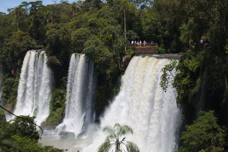 A group of tourist visit a waterfal located in Iguazu river on Argentina Architecture Beauty In Nature Blurred Motion Built Structure Dam Day Forest Long Exposure Motion Nature No People Outdoors Power In Nature River Scenics Sky Spraying Tree Water Waterfall