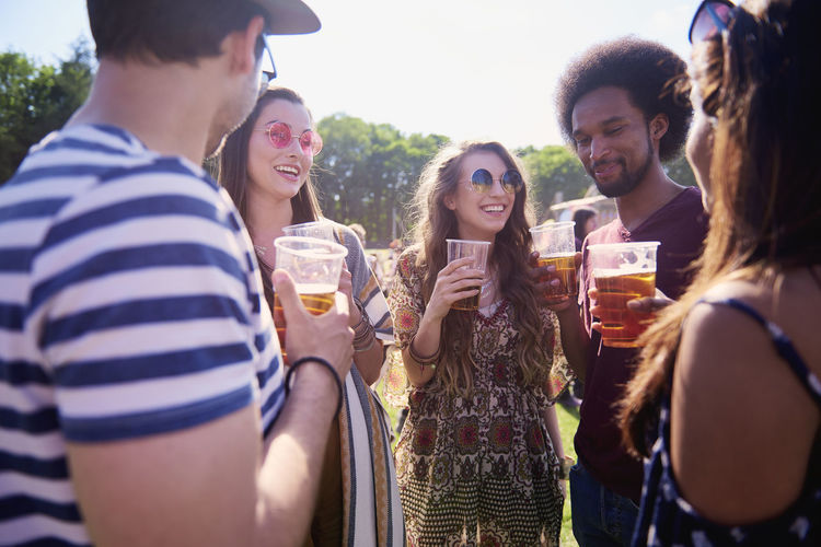 Friends drinking beer at the party Music Festival Beer Drink Friends Festival Outdoors Alcohol Traditional Festival People Group Of People Meeting Circle Discussion Talk African Carefree Happiness Youth Culture Sunlight Summer Party Enjoyment African American Celebration Coachella Valley Traveling Carnival Social Gathering Freedom Hold Copy Space Joy Live Event Popular Music Concert Simplicity Smiling Toothy Smile Thirsty  Sunglasses Vacations Adult Young Adult STAND Weekend Activities