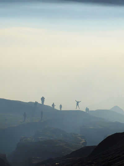 Traveller are enjoying Bromo Tengger Semeru Park in a foggy morning. This could be seen from Mount Bromo during sunrise. Hills Morning Sun Silhouette Tranquility Beauty In Nature Bromo Destination Foggy Foggy Landscape Foggy Morning Layers Leisure Activity Nature Outdoors Ray Of Light Scenics - Nature Sky Tourism Tranquil Scene