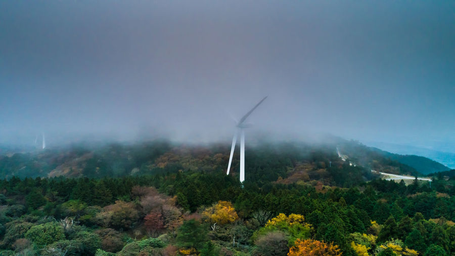 Shot in drone. A wind farm group located on the mountain ridge. Wind generators standing in the fog. Iga city, Mie prefecture, Japan Wind Turbine Wind power wind farm environmental conservation renewable energy Plant fog alternative energy beauty in Nature scenics - nature landscape outdoors power in nature hilltop sky foggy sustainable resources Japan autamn Aerial View Aerial Drone  Wind Turbine Wind Power Wind Farm Environmental Conservation Renewable Energy Plant Fog Alternative Energy Beauty In Nature Scenics - Nature Landscape Outdoors Power In Nature Hilltop Sky Foggy Sustainable Resources Japan Autamn Color Windmill Mountain Nature Wind Power Generator Wind Power Plant