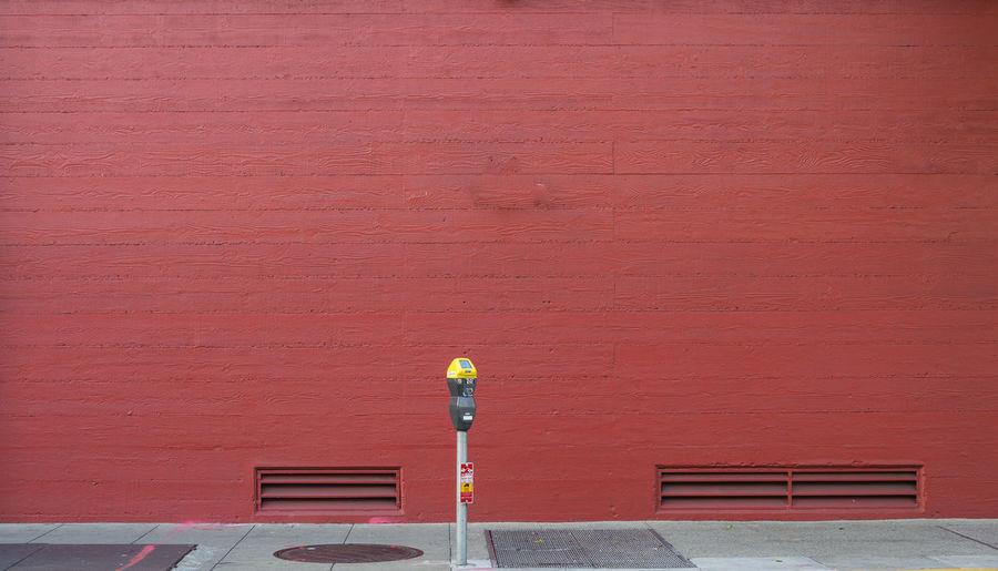 Red umbrella on brick wall