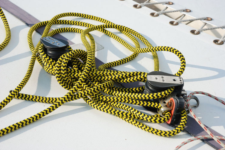 Halyard on a boat No People Close-up Metal Equipment High Angle View Day Gear Technology Directly Above Nature Accuracy Complexity Rope White Background Tangled Halyard Boat Boating Boat Deck Catamaran Sailing Sailing Boat Sail