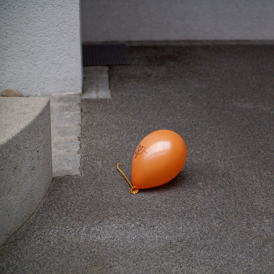 Mimotai Orange Color Day Architecture High Angle View No People City Outdoors Sitting Security Single Object Protection Safety Gray Balloon Road Forgotten Stranded Rubber