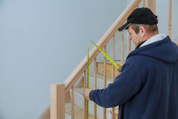 Man measuring steps at home