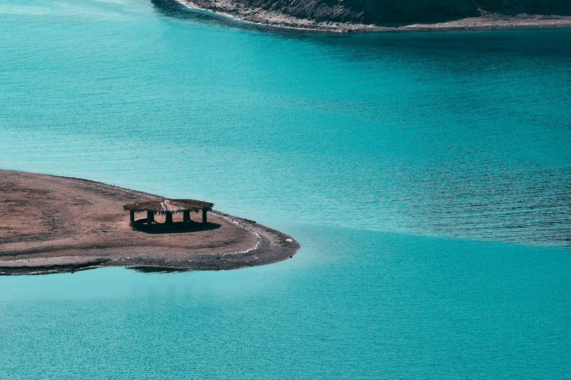 High angle view of sea seen from side mountain for a lonely hut inside the water