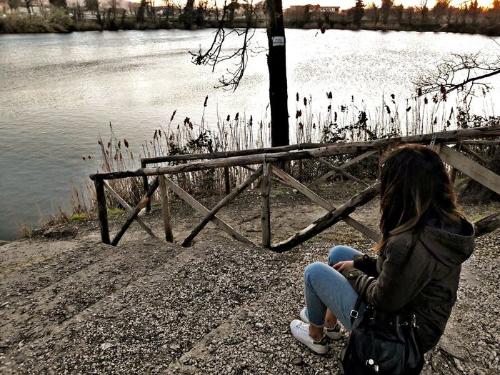 Sitting One Person Water Outdoors Day Lake Young Adult Full Length Young Women Nature People Adult Adults Only One Young Woman Only Beauty In Nature