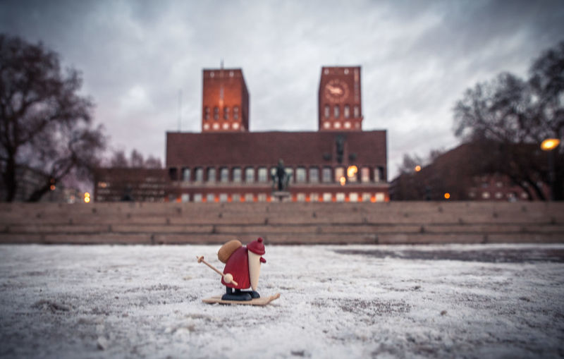 Figurine On Snow Covered Field