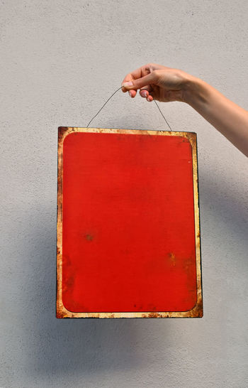 Old grunge clean red metal message board Copy Space Corroded Red Blank Board Clean Close-up Copy Space Finger Grunge Hand Holding Human Body Part Human Finger Human Hand Metal Old One Person Red Red Board Vintage