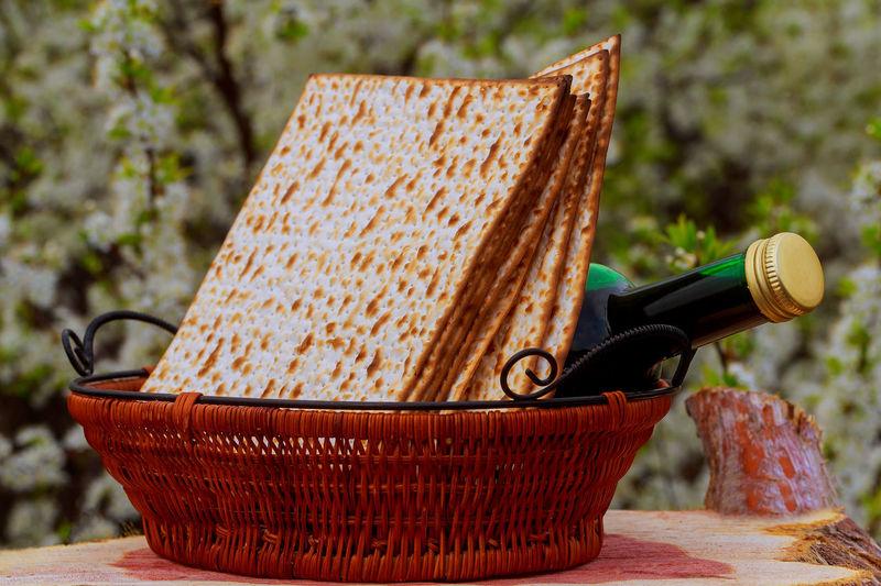 Crackers with wine bottle in wicker basket