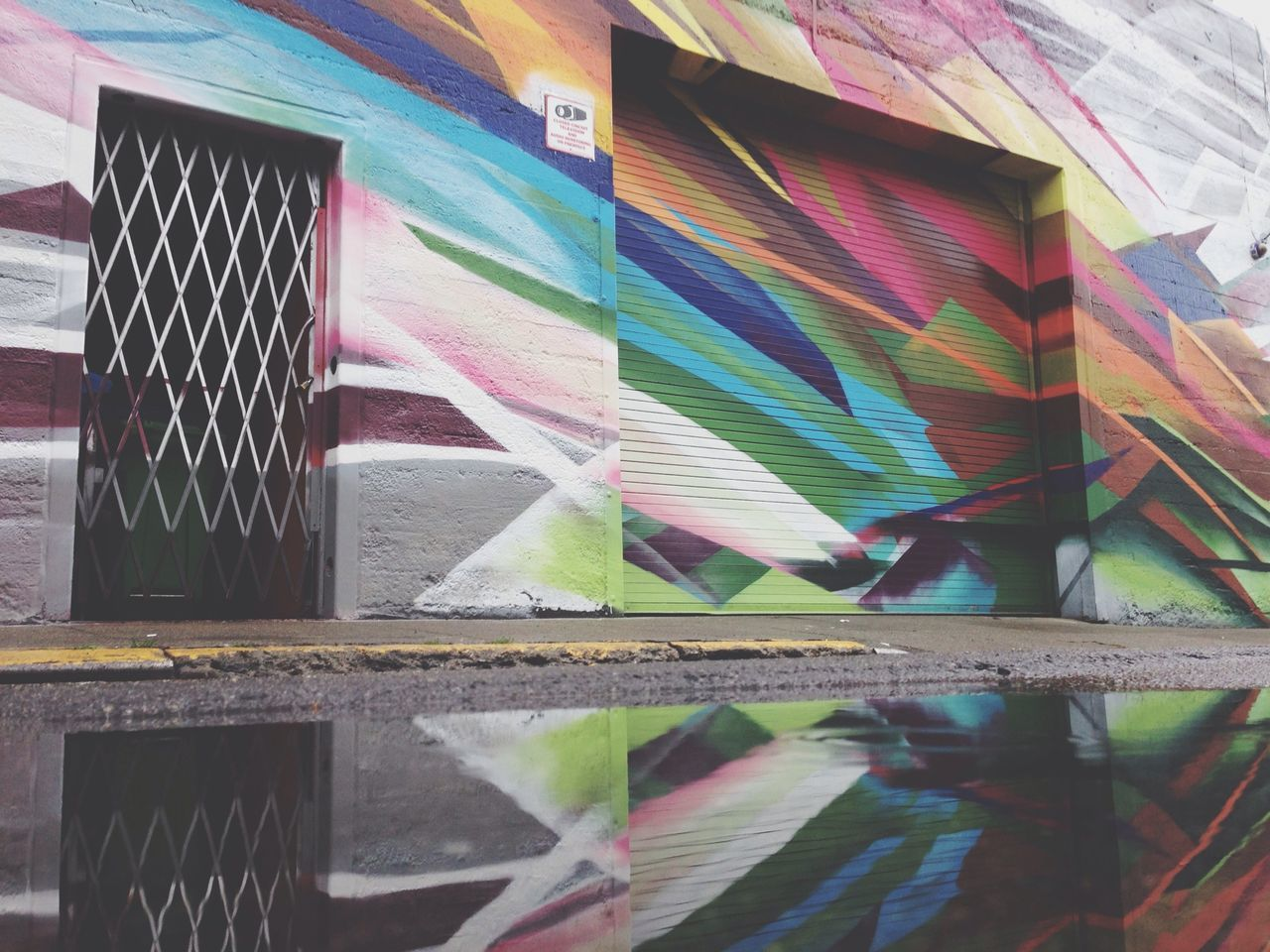 View of colorful wall with reflection in water
