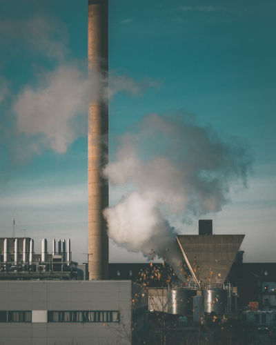 The Architect - 2018 EyeEm Awards Air Pollution Architecture Atmospheric Building Exterior Built Structure Chimney City Cooling Tower Ecosystem  Environmental Issues Factory Industry Pollution Sky Smog Smoke Stack