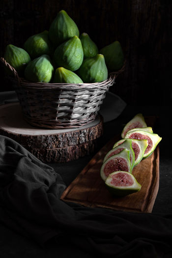 Still life with figs inside a basket on old wooden table. Autumn Collection Fine Art Photograhy Still Life Photography Wooden Table Autumnal Autumnal Food Crop  darkness and light Exotic Fruits Fig Figs Food Fresh Fruit Fruit Fruit Basket Fruit On Wooden Board Fruit Photography Healthy Food Moody Sliced Fruit Still Life Still Life Food Still Life Fruit Still Life Photograpy Sweet Taste