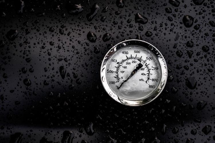 Gauge on wet glass during rainy season