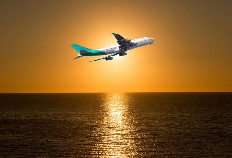 Aerospace Industry Air Vehicle Airplane Beauty In Nature Flying Horizon Horizon Over Water Mid-air Mode Of Transportation Motion Nature No People Orange Color Outdoors Scenics - Nature Sea Sky Sunset Transportation Water Waterfront