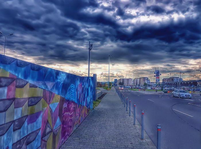 Multi colored cityscape against sky