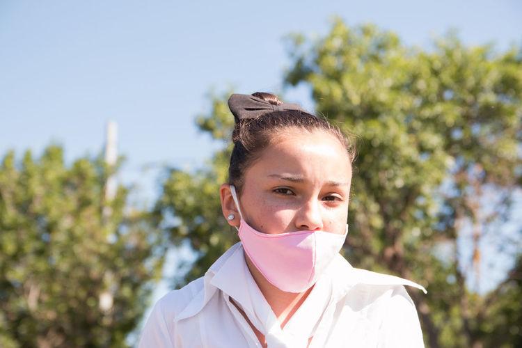 Portrait of girl wearing medical face mask