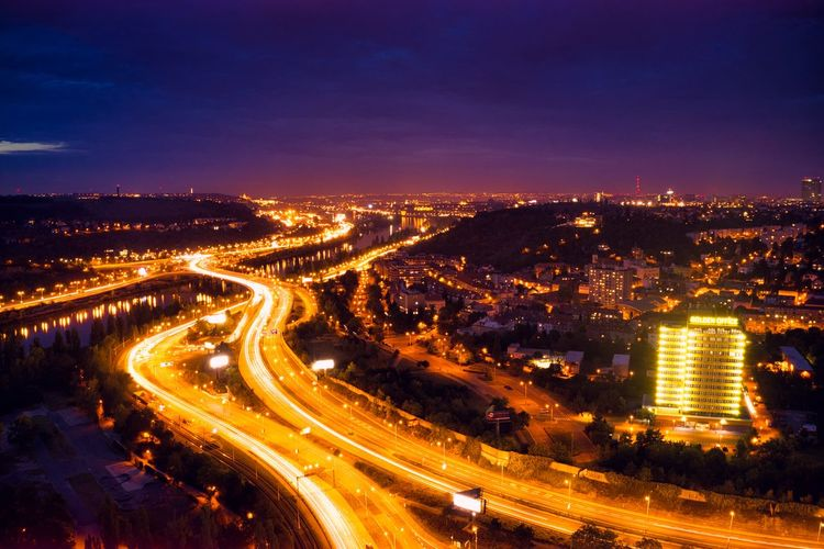Above highway at night Illuminated City Night Architecture Road Built Structure Building Exterior Long Exposure Light Trail Sky Motion Street Cityscape No People Transportation Glowing High Angle View