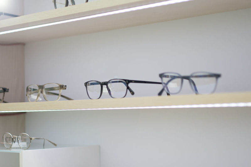 eyeglasses displayed on the shelf Indoors  No People Shelf White Color Fashion Retail  Glasses Close-up Day Shopping Store Eyeglasses  Displayed White Choice Sale Frame Accessory Wear Design Assortment Vision Fashion Optician Modern