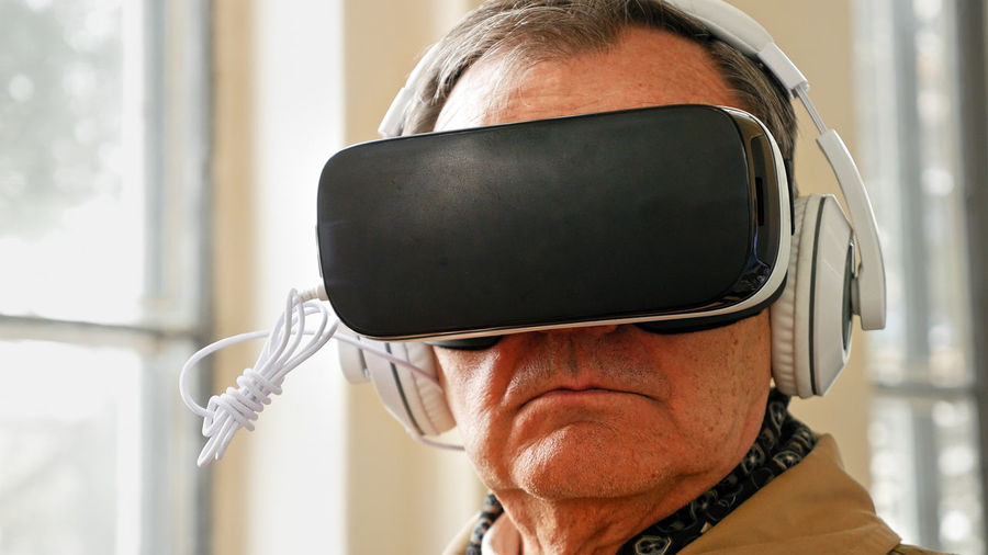 Close-up of man wearing virtual reality simulator
