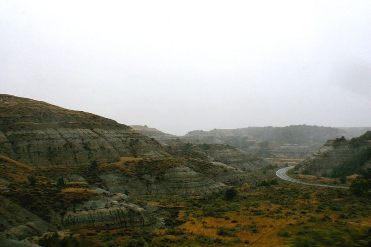 Road thru Theodore Roosevelt National Park Theodore Roosevelt National Park North Dakota Badlands Mountains Geology Landscapes With WhiteWall
