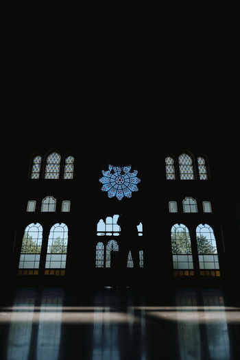 Built Structure Window Architecture Indoors  Building Place Of Worship Religion Spirituality Belief No People Low Angle View Stained Glass Glass - Material Copy Space Night Illuminated Dark Glass Floral Pattern The Great Outdoors - 2019 EyeEm Awards