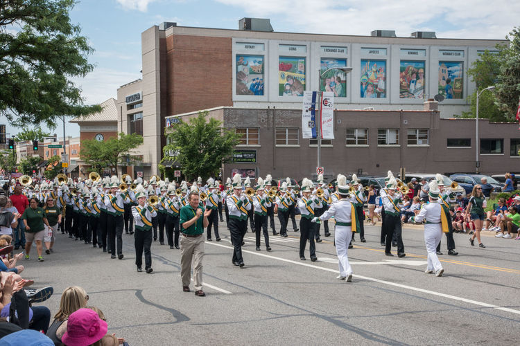 Naperville, Illinois, United States-May 29,2017: Waubonsie Valley High School marching in Memorial Day Parade with crowd in Naperville, Illinois Large Group Of People Crowd Street City March Marching Marching Band High School Students Waubonsie Valley In A Row Parade Celebration Event Performance Music Uniform Clothing Brass Instrument  Musical Instrument Music Entertainment Performance Group Teenagers  Downtown District