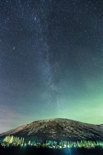 Scenic View Of Mountain Against Milky Way At Night