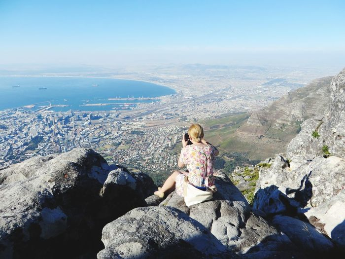 Full Length Vacations Casual Clothing Vacation Photos   Landscape Scenics Nature Photographer In The Shot Photographer City In The Distance View From The Top View From Above Spontaneous Moments Trying To Take A Photo ✌ The Week On EyeEm Amazing View Cape Town In The Distance Capture The Moment EyeEmNewHere Taking Photos Table Mountain View Cape Town, South Africa Vacation Photos   Human Back Breathing Space Lost In The Landscape Perspectives On Nature Be. Ready. Go Higher
