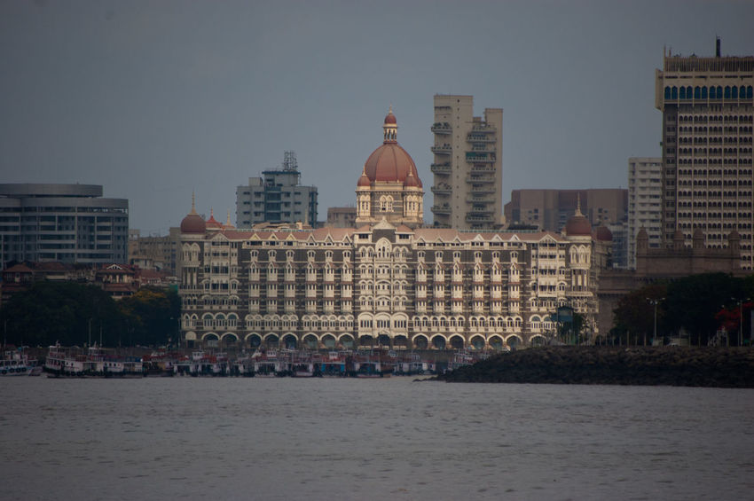 Architecture Building Story Built Structure City City Life Cityscape Financial District  Hotel The Royal Suites Turquesa By Palladium In Front Of Incredible India India Tour Mumbai Taj Mahal Hotel, Mumb Tall Tall - High Tower Tranquility Travel Destinations Urban Skyline Water Waterfront