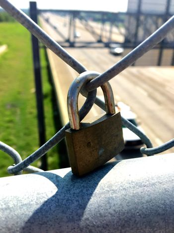 Locked up Rope Sunlight Metal Close-up Shadow Protection Focus On Foreground Selective Focus Outdoor Play Equipment Anchor - Vessel Part Day Cleat Watering Can Strength Chain Barrier Padlock Boundary Sunlight Security No People Safety Fence Outdoors Chainlink Fence Nature Lock