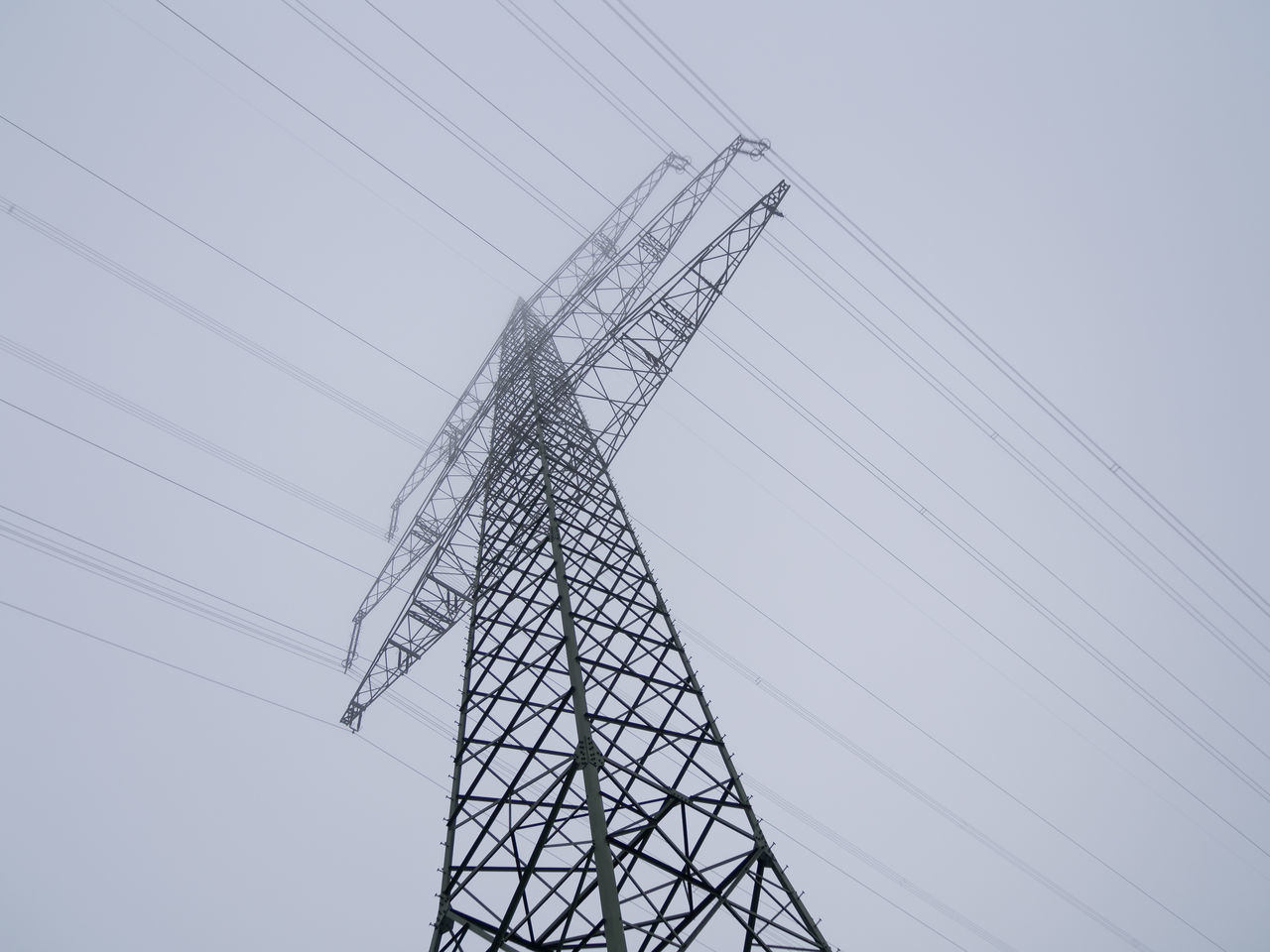 technology, power supply, electricity, low angle view, cable, power line, electricity pylon, connection, fuel and power generation, sky, metal, nature, no people, tall - high, outdoors, clear sky, day, complexity, built structure, industry, iron - metal, electrical equipment
