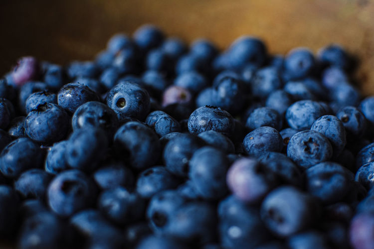 Close up of blueberries in a wooden bowl