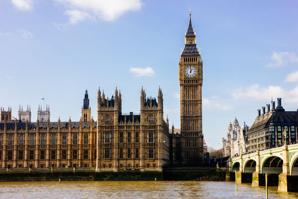 The Big Ben and the Houses of Parliament on the other side of the river Thames in London, UK. Architecture Big Ben Blue Sky Bridge British Famous Place Historic Landmark Parliament River Thames United Kingdom Waterfront
