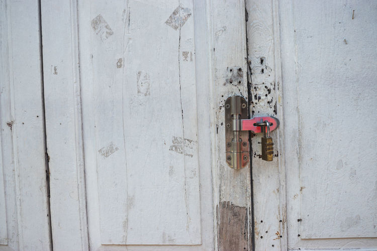 Safety Door Wood - Material Entrance Security Protection No People Lock Wall - Building Feature Padlock Day Metal Closed Built Structure Architecture Old Close-up Outdoors Full Frame Weathered Latch