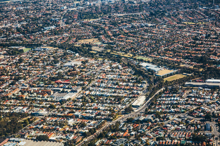 High Angle View Of Street Amidst Houses In City