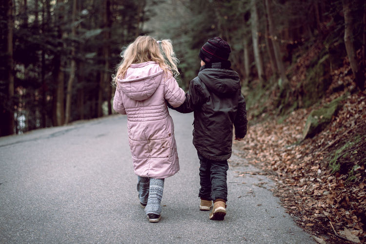 Let's be together, forever. Blond Hair Boy Child Childhood Children Day Dirt Footpath Forest Friendship Full Length Girl Happiness Holding Hands Love Nature Outdoors People Rear View Togetherness Two People Walking Warm Clothing EyeEm Diversity This Is Masculinity This Is Family