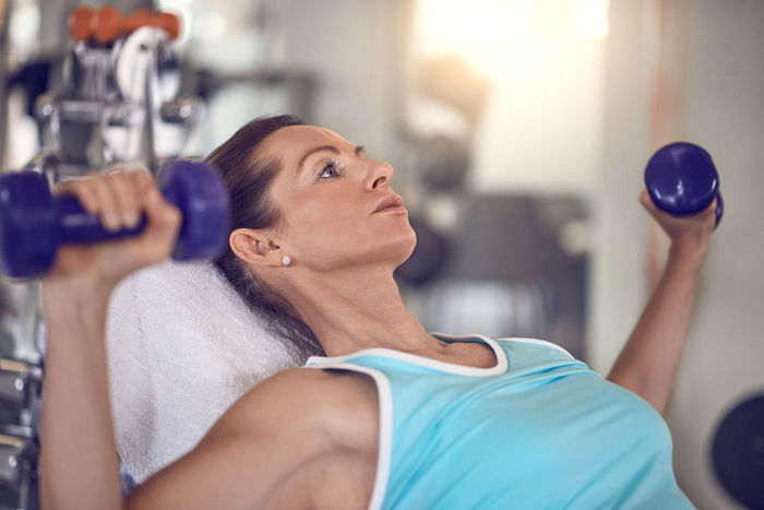 Fit middle-aged woman exercising with weights Arms Copy Space Exercising Middle East Adult Best Ager Body Care Exercise Equipment Exercising Fit Fitness Fitness Training Gym Health Club Healthy Lifestyle Indoors  Lifestyles One Person One Woman Only Weights Wellbeing