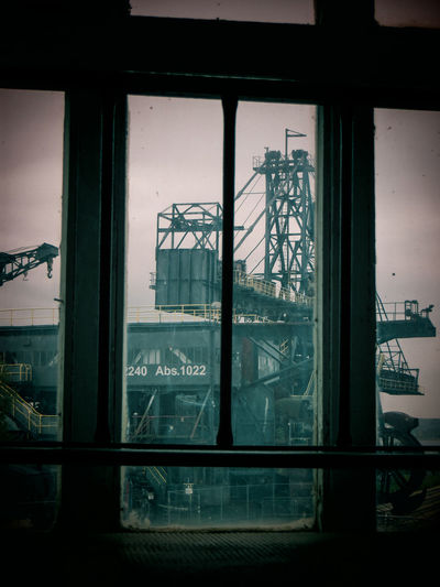 Brown Coal Mine Architecture Brown Coal Surface Mining Area Building Exterior Built Structure City Close-up Day Ferropolis Glass - Material Indoors  Looking Through Window Mining No People Open-cast Mining Reflection Sky Text Transparent Window
