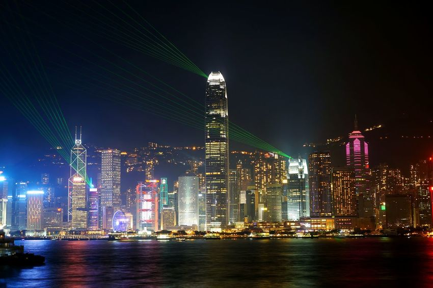 Symphony of lights in hong kong Skyscraper Night Urban Skyline Architecture Modern Cityscape Downtown District City Business Finance And Industry Travel Destinations Building Exterior Illuminated Travel Office Building Exterior Tourism Built Structure Awe Nightlife Outdoors Office