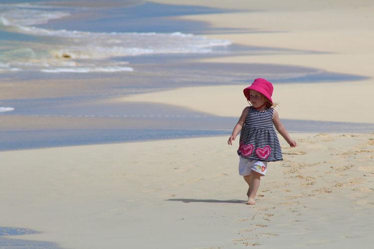Full length of girl walking on beach