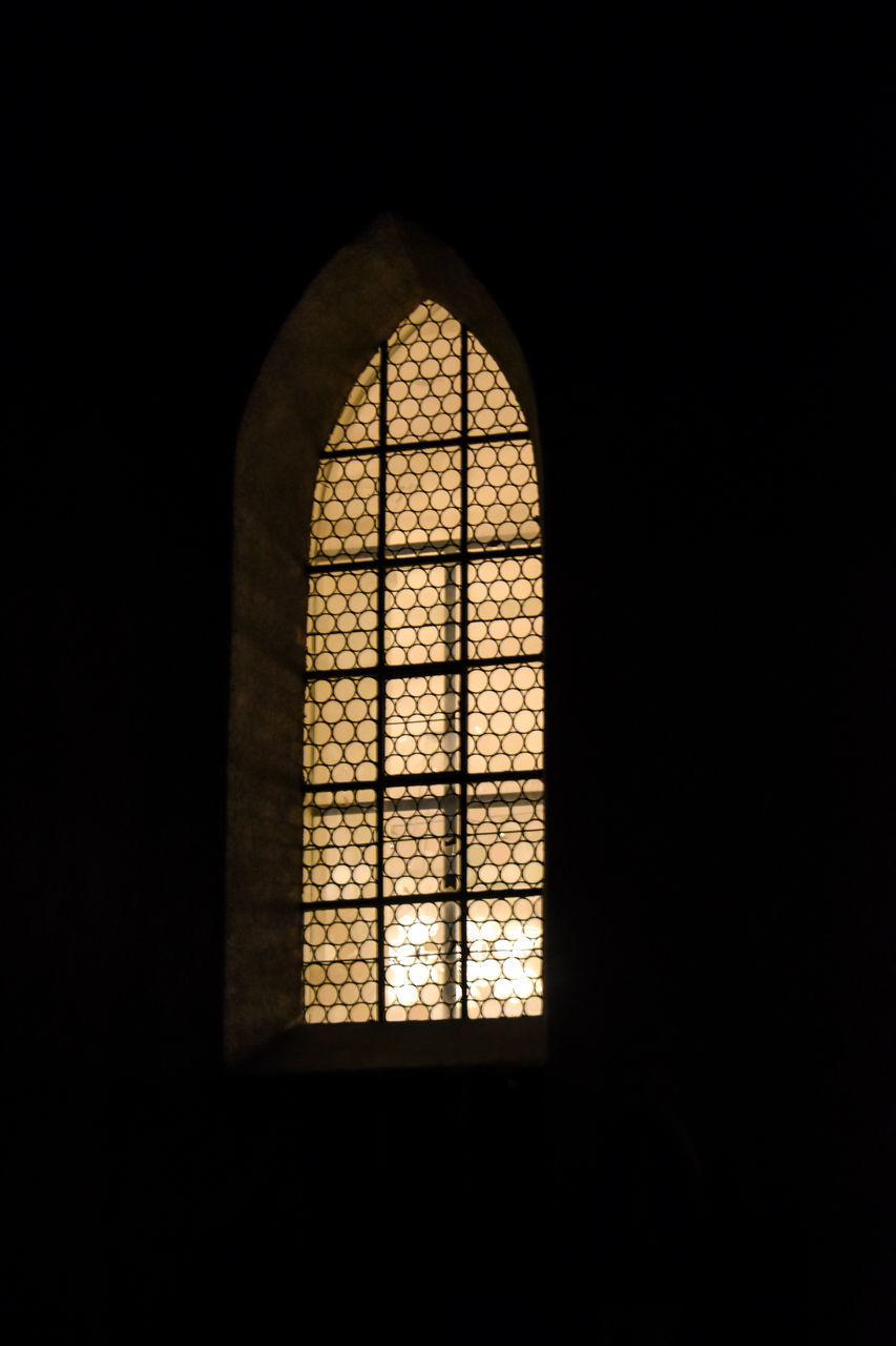 WINDOW IN TEMPLE SEEN THROUGH GLASS DOOR