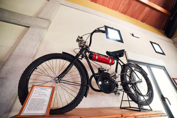 High angle view of bicycle parked on wall