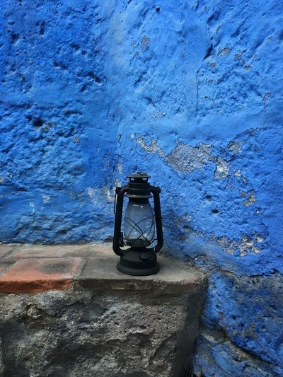 A lamp against a blue wall Blue Arequipa Nunnery Monastery Convent Andes Peru IPhone Traveling Travel
