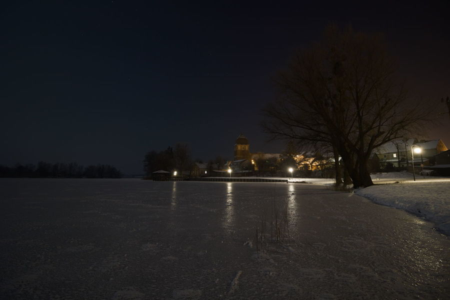 Beauty In Nature City Cold Temperature Lake Masuren Masuria Mazury Moonlight Nature Night No People Outdoors Reflection Snow Town Tree Water Winter