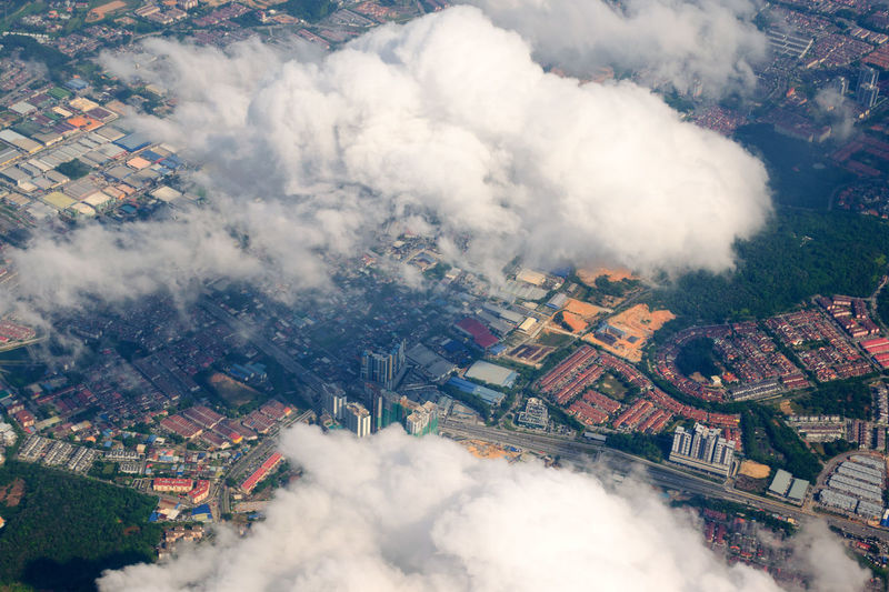 Aerial view of the modern city in malaysia with houses, streets. view from an airplane