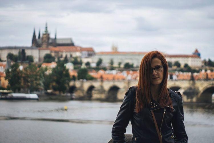 Woman posing in front of charles bridge