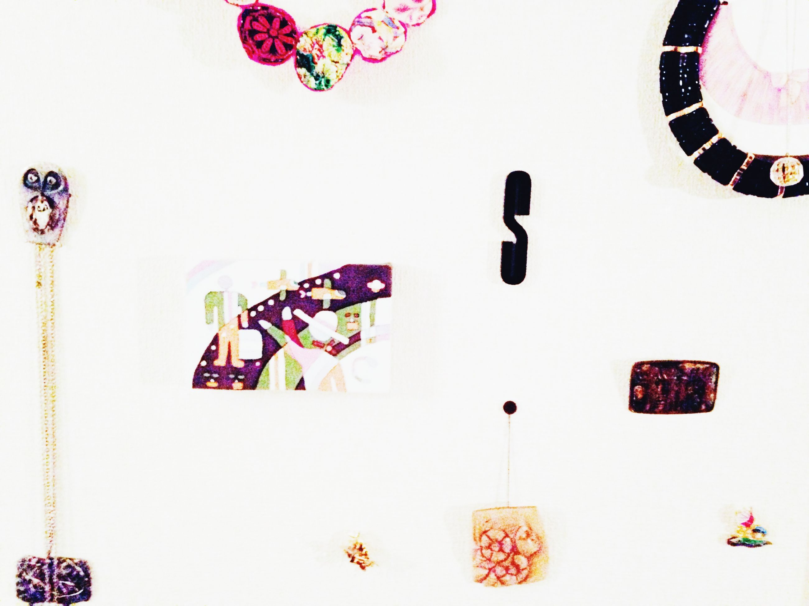 multi colored, art, art and craft, indoors, creativity, text, wall - building feature, variation, copy space, animal representation, decoration, communication, hanging, western script, no people, low angle view, human representation, circle, white color, white background
