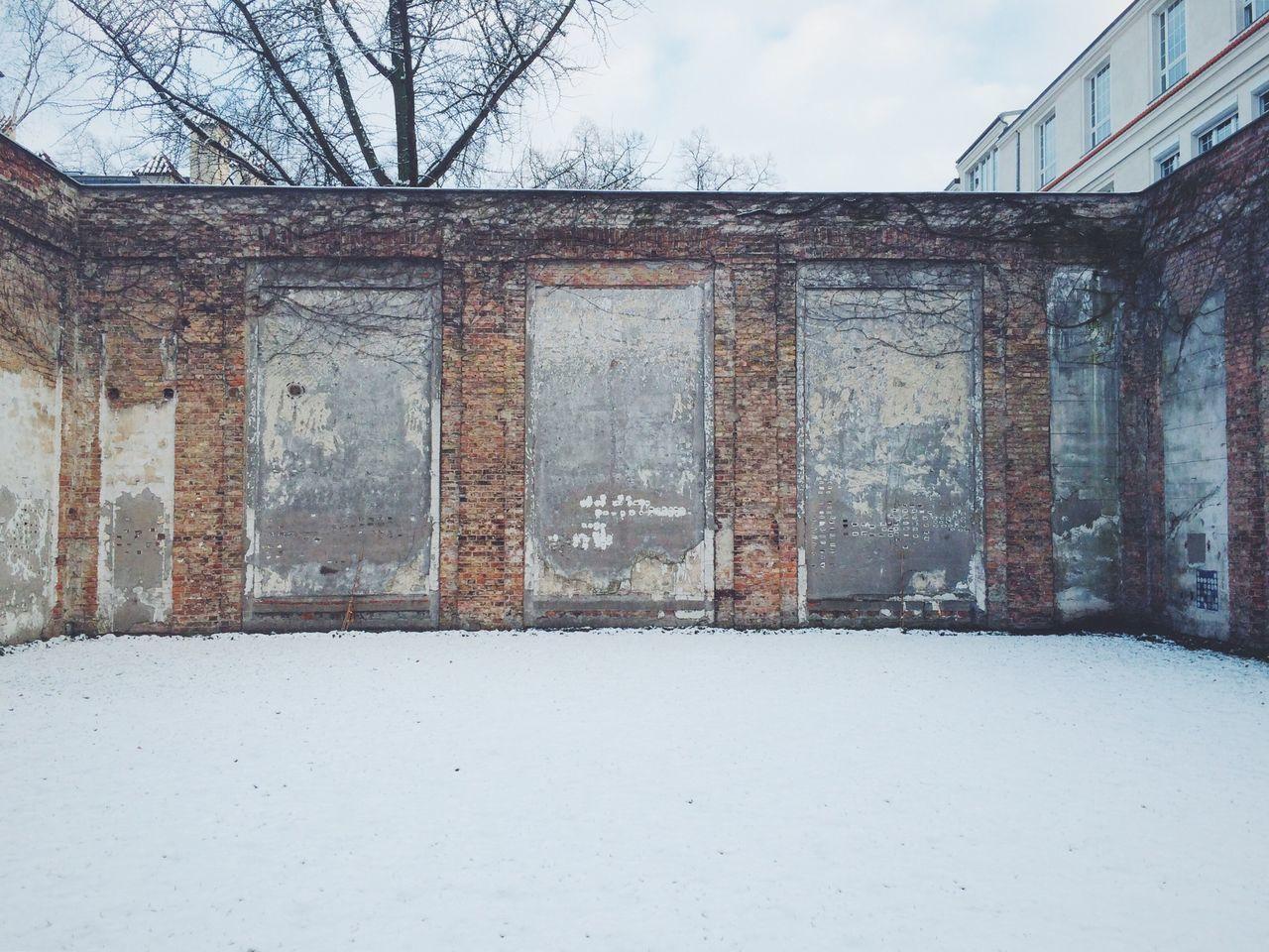 Buildings against sky during winter